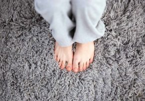 Closeup image of female feet on clean carpet | Quality Counts Carpet